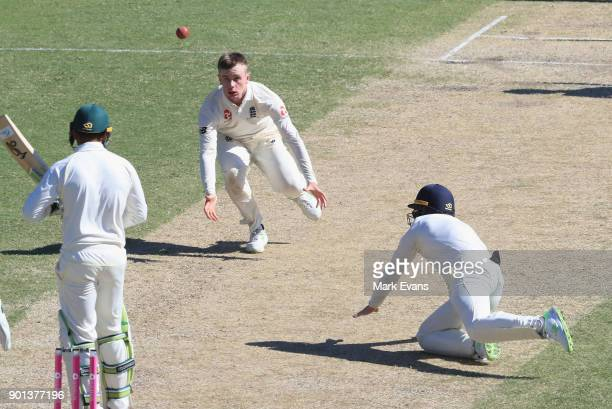 Mason Crane of England attempts to catch a ball from Usman Khawaja of Australia during day two of the Fifth Test match in the 2017/18 Ashes Series...