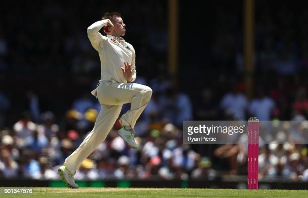 Mason Crane of England bowls his first ball in his test career during day two of the Fifth Test match in the 2017/18 Ashes Series between Australia...