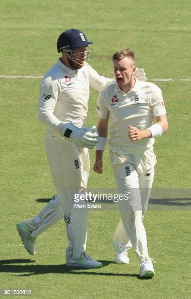 Mason Crane of England celebrates his first test wicket of Usman Khawaja of Australia during day three of the Fifth Test match in the 2017/18 Ashes...