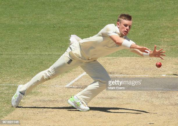 Mason Crane of England fields off his own bowling during day three of the Fifth Test match in the 2017/18 Ashes Series between Australia and England...