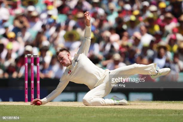 Mason Crane of England fields off his own bowling during day two of the Fifth Test match in the 2017/18 Ashes Series between Australia and England at...