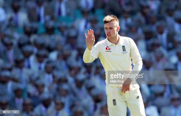 Mason Crane of England gestures to fielders during day two of the Fifth Test match in the 2017/18 Ashes Series between Australia and England at...