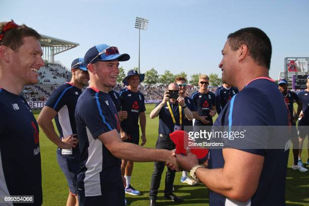 Mason Crane of England is presented with his first cap by Adam Hollioake prior to the 1st NatWest T20 International match between England and South...
