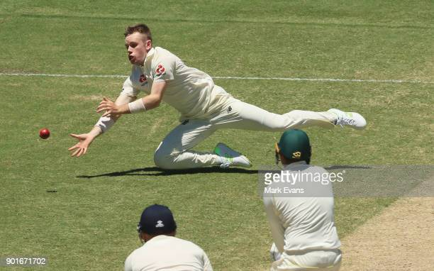 Mason Crane of England just fails to catch a ball from Usman Khawaja of Australia during day three of the Fifth Test match in the 2017/18 Ashes...