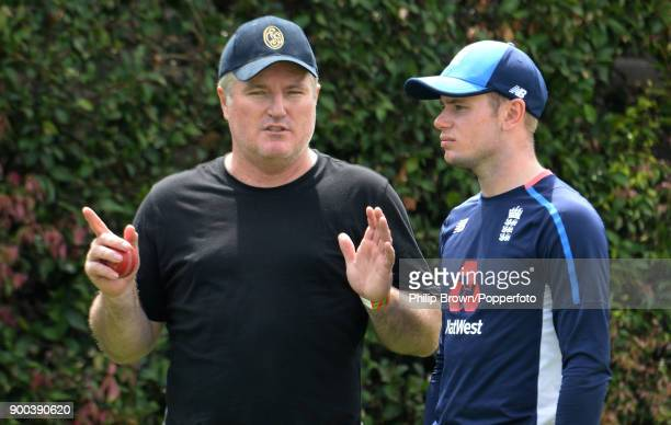 Mason Crane of England listens to coach Stuart MacGill during a training session before the fifth Ashes cricket test match between Australia and...
