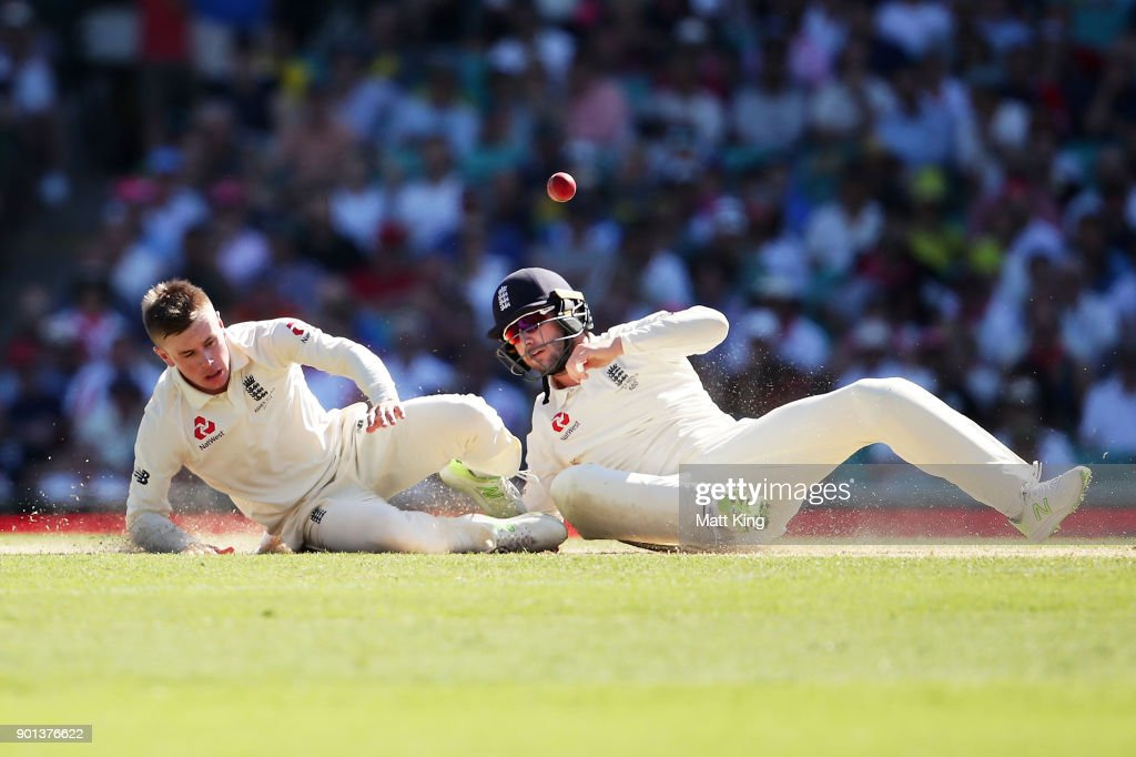Mason Crane of England nearly collides with fielder Mark Stoneman of England as he attempts to catch his own delivery during day two of the Fifth Test match in the 2017/18 Ashes Series between Australia and England at Sydney Cricket Ground on January 5, 2018 in Sydney, Australia.