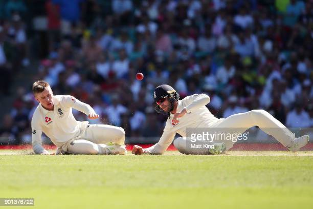 Mason Crane of England nearly collides with fielder Mark Stoneman of England as he attempts to catch his own delivery during day two of the Fifth...