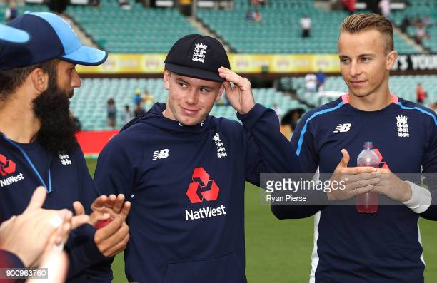Mason Crane of England receives his test cap during day one of the Fifth Test match in the 2017/18 Ashes Series between Australia and England at...