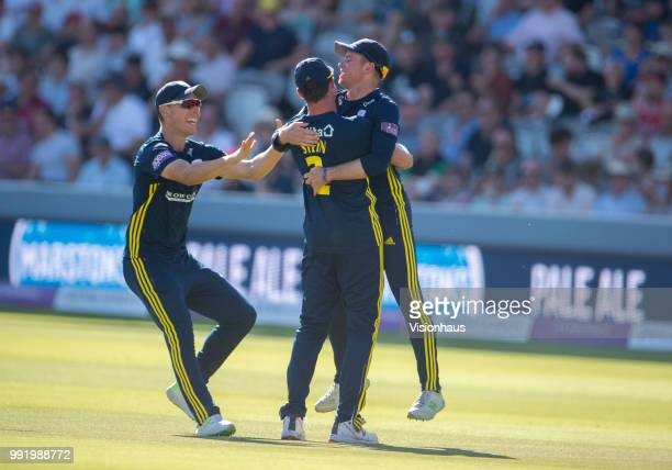 Mason Crane of Hampshire is congratulated by Dale Steyn and Joe Weatherley after running out Alex Blake of Kent during the Royal London OneDay Cup...