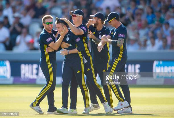 Mason Crane of Hampshire is congratulated by his team mates after running out Alex Blake of Kent during the Royal London OneDay Cup match between...