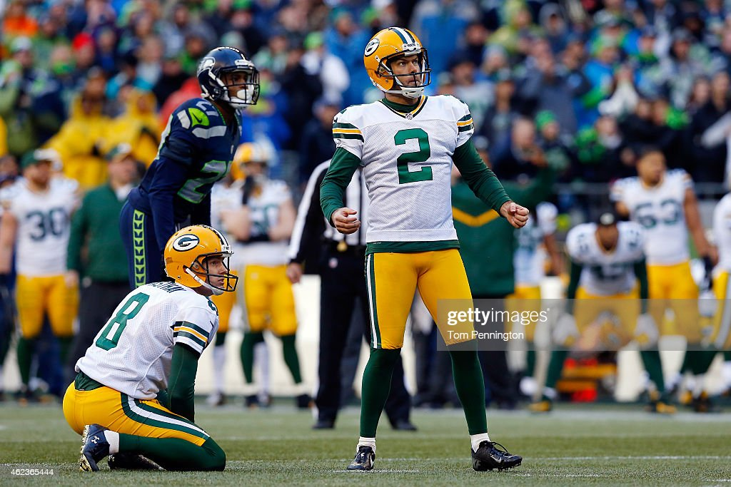 Mason Crosby #2 and Tim Masthay #8 of the Green Bay Packers react against the Seattle Seahawks during the 2015 NFC Championship game at CenturyLink Field on January 18, 2015 in Seattle, Washington.