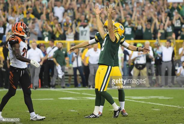 Mason Crosby of the Green Bay Packers celebrates after kicking the gamewinning field goal to defeat the Cincinnati Bengals in overtime at Lambeau...