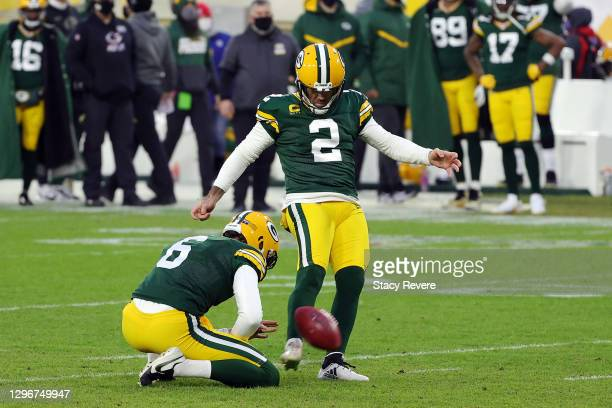Mason Crosby of the Green Bay Packers kicks a field goal in the first quarter against the Los Angeles Rams during the NFC Divisional Playoff game at...