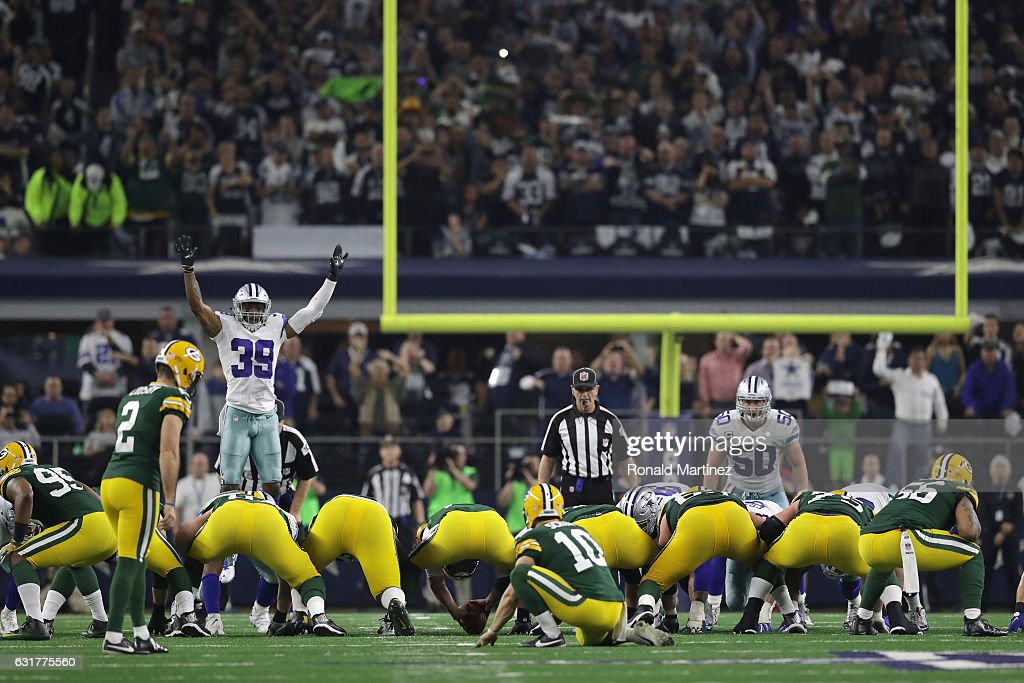 Mason Crosby #2 of the Green Bay Packers lines up to kick the game-winning field goal against the Dallas Cowboys in the NFC Divisional Playoff game at AT&T Stadium on January 15, 2017 in Arlington, Texas.