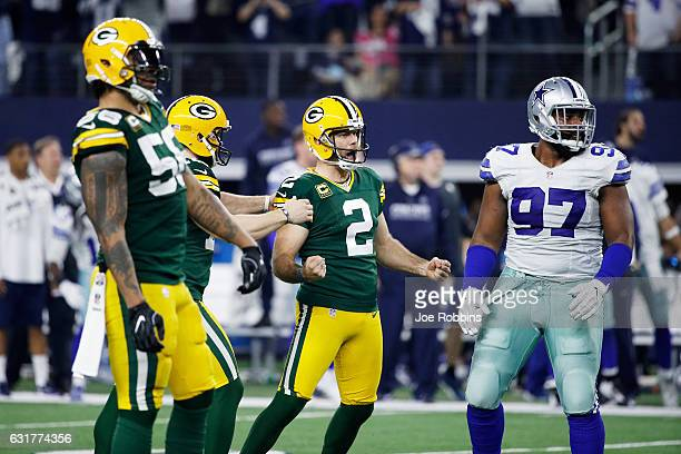 Mason Crosby of the Green Bay Packers reacts after kicking a field goal in the second half during the NFC Divisional Playoff Game against the Dallas...