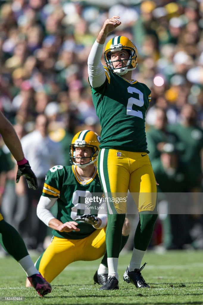 Mason Crosby #2 of the Green Bay Packers watches a field goal against the Detroit Lions at Lambeau Field on October 6, 2013 in Green Bay, Wisconsin. The Packers defeated the Lions 22-9.