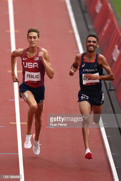 Mason Ferlic of Team United States and Djilali Bedrani of Team France compete during round one of the Men's 3000m Steeplechase heats on day seven of...