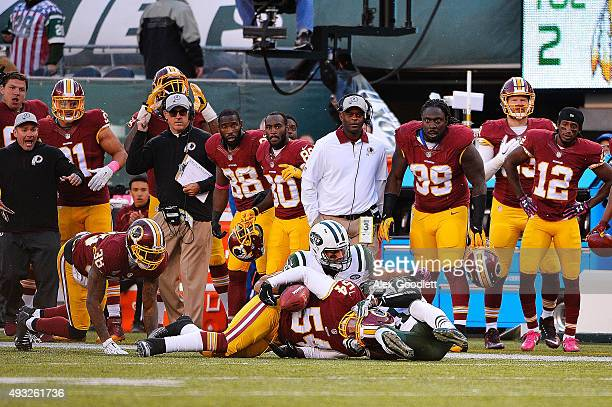 Mason Foster of the Washington Redskins battles for an onside kick with Jeremy Kerley and Eric Decker of the New York Jets during the fourth quarter...