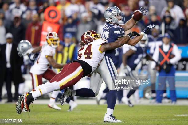 Mason Foster of the Washington Redskins defends a pass intended for Dalton Schultz of the Dallas Cowboys in the fourth quarter of the game at...