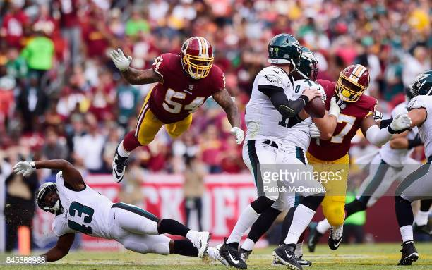 Mason Foster of the Washington Redskins flys in the air to tackle Quarterback Carson Wentz of the Philadelphia Eagles in the fourth quarter at...