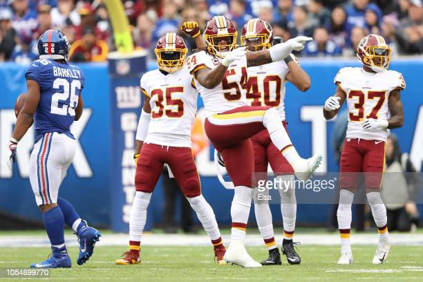 Mason Foster of the Washington Redskins reacts after making a stop against the New York Giants during the second quarter at MetLife Stadium on...