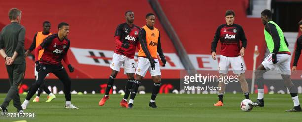 Mason Greenwood Aaron WanBissaka Anthony Martial Harry Maguire Paul Pogba of Manchester United warm up ahead of the Premier League match between...