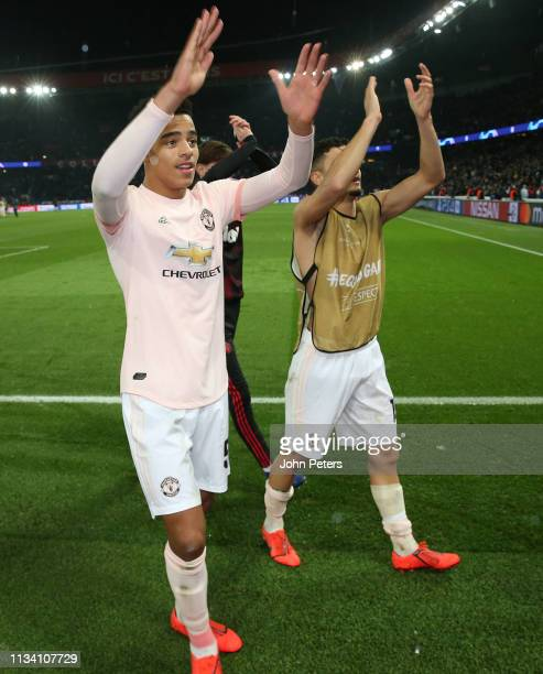Mason Greenwood and Andreas Pereira of Manchester United celebrates at the final whistle during the UEFA Champions League Round of 16 Second Leg...