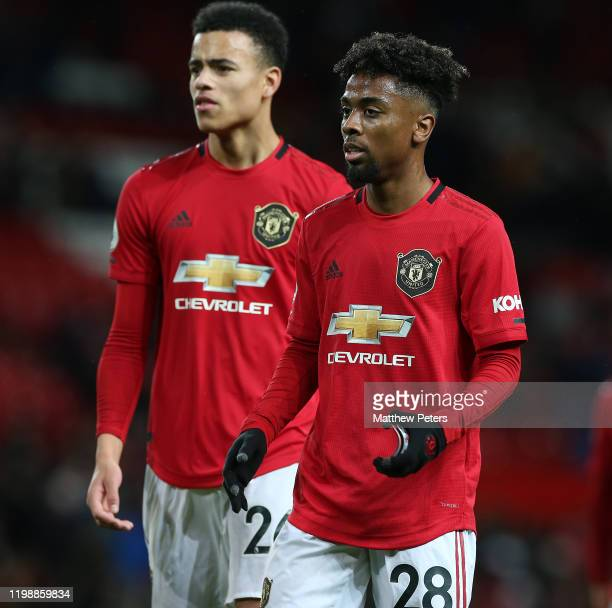 Mason Greenwood and Angel Gomes of Manchester United walk off after the Premier League match between Manchester United and Norwich City at Old...