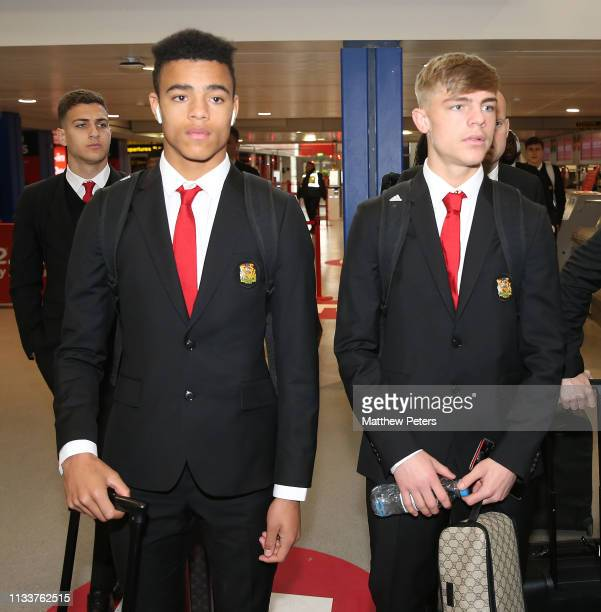 Mason Greenwood and Brandon Williams of Manchester United check in ahead of the club's flight to Paris for the Champions League match against Paris...