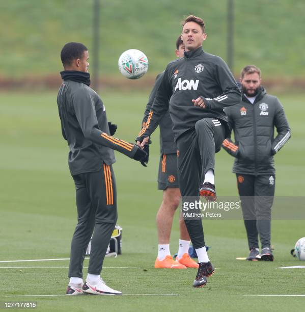 Mason Greenwood and Nemanja Matic of Manchester United in action during a first team training session at Aon Training Complex on September 28 2020 in...