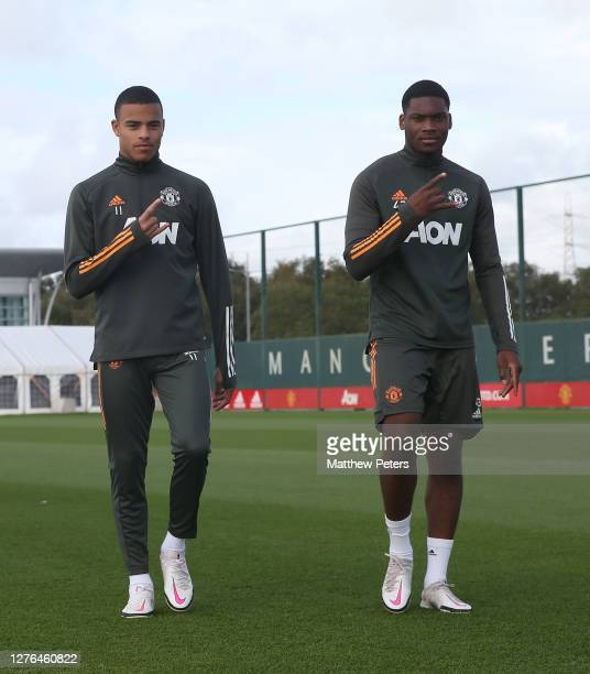 Mason Greenwood and Teden Mengi of Manchester United in action during a first team training session at Aon Training Complex on September 24 2020 in...