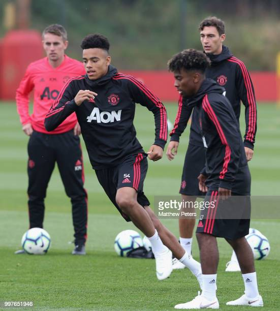 Mason Greenwood Angel Gomes and Matteo Darmian of Manchester United in action during a first team training session at Aon Training Complex on July 13...