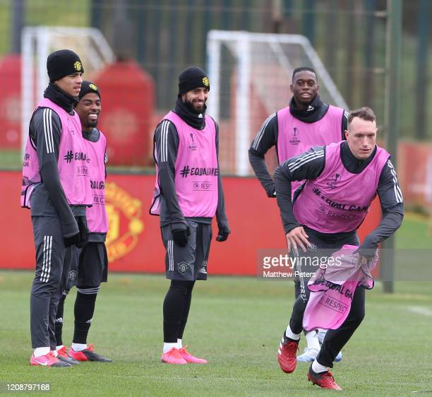 Mason Greenwood, Angel Gomes, Bruno Fernandes, Aaron Wan-Bissaka and Phil Jones of Manchester United in action during a first team training session...