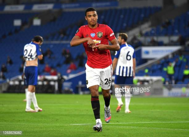 Mason Greenwood celebrates after scoring his sides first goal during the Premier League match between Brighton & Hove Albion and Manchester United at...