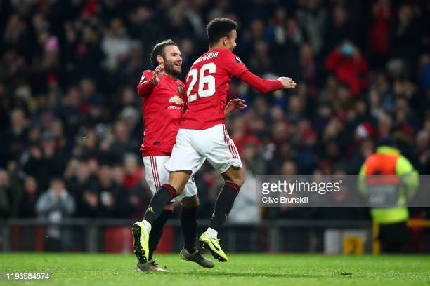Mason Greenwood celebrates after scoring his team's fourth goal with Juan Mata of Manchester United during the UEFA Europa League group L match...
