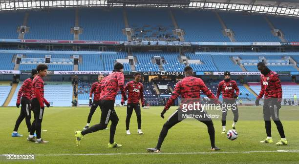 Mason Greenwood, Eric Bailly, Shola Shoretire, Alex Telles, Axel Tuanzebe, Eric Bailly of Manchester United warm up ahead of the Premier League match...