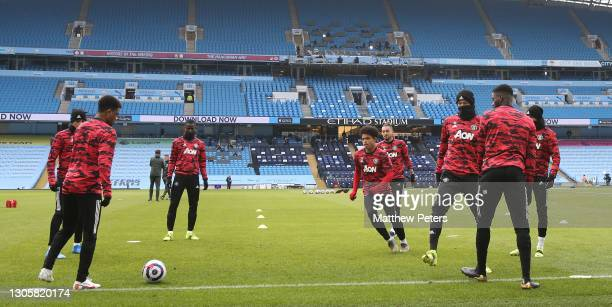 Mason Greenwood, Eric Bailly, SShola Shoretire, Alex Telles, Axel Tuanzebe of Manchester United warm up ahead of the Premier League match between...