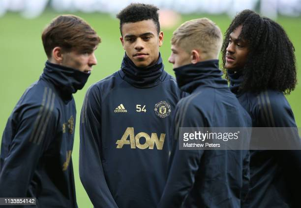 Mason Greenwood James Garner Brandon Williams and Tahith Chong of Manchester United in action during a first team training session at Park Des...