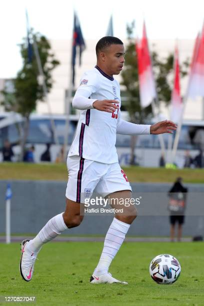 Mason Greenwood of England runs with the ball during the UEFA Nations League group stage match between Iceland and England at Laugardalsvollur...