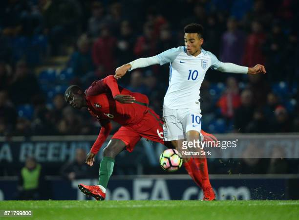 Mason Greenwood of England U17s and Henrique Jocu of Portugal 17s in action during the International Match between England U17 and Portugal U17 at...