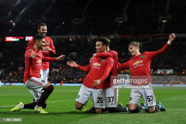 Mason Greenwood of Man Utd is joined by Andreas Pereira of Man Utd and James Garner of Man Utd as he celebrates after scoring their 4th goal during...