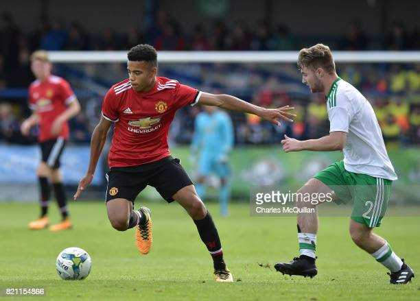 Mason Greenwood of Manchester United and Cormac Lawlor of Northern Ireland during the NI Super Cup game between Manchester United u18s and Northern...