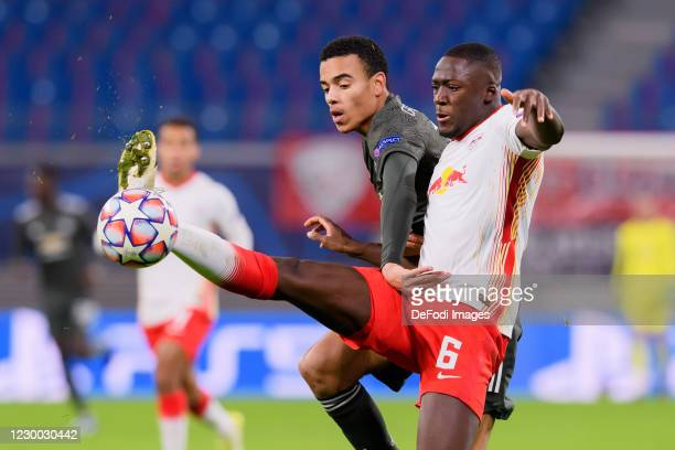 Mason Greenwood of Manchester United and Ibrahima Konate of RasenBallsport Leipzig battle for the ball during the UEFA Champions League Group H stage...