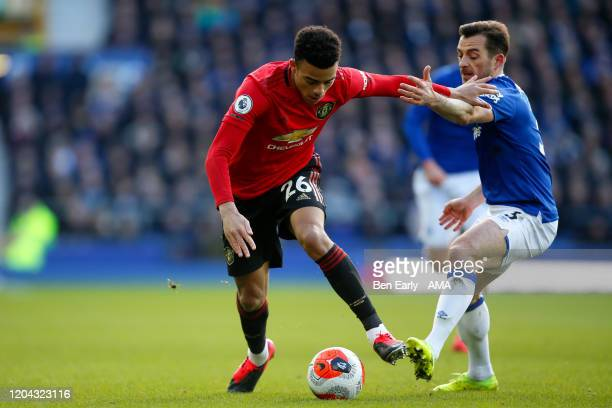 Mason Greenwood of Manchester United and Leighton Baines of Everton FC during the Premier League match between Everton FC and Manchester United at...