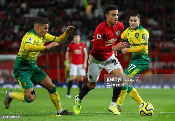 Mason Greenwood of Manchester United battles for possession with Max Aarons and Emiliano Buendia of Norwich City during the Premier League match...