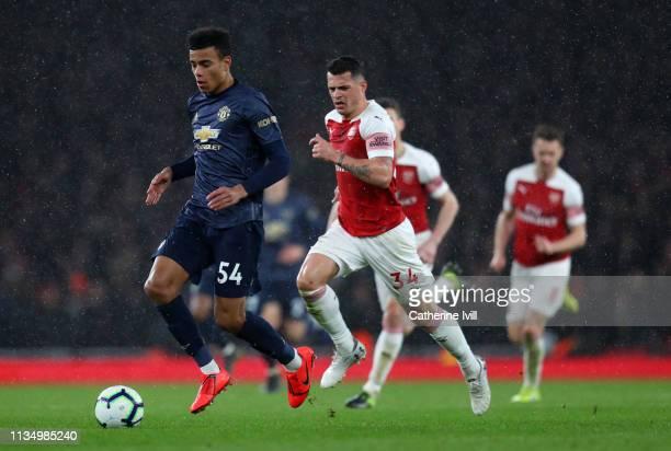 Mason Greenwood of Manchester United beats Granit Xhaka of Arsenal during the Premier League match between Arsenal FC and Manchester United at...