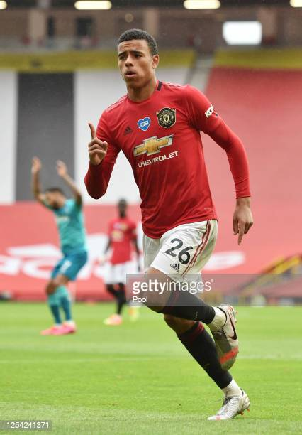 Mason Greenwood of Manchester United celebrates after scoring his team's fourth goal during the Premier League match between Manchester United and...