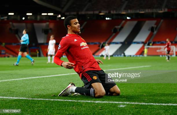 Mason Greenwood of Manchester United celebrates after scoring his sides first goal during the UEFA Champions League Group H stage match between...