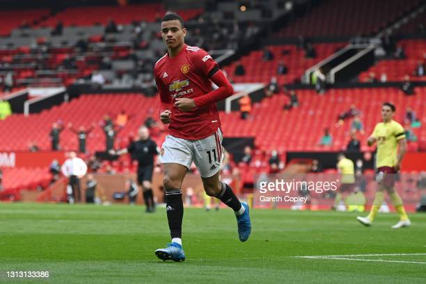 Mason Greenwood of Manchester United celebrates after scoring his team's first goal during the Premier League match between Manchester United and...