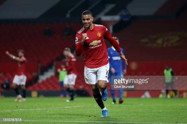 Mason Greenwood of Manchester United celebrates after scoring their team's second goal during the Premier League match between Manchester United and...